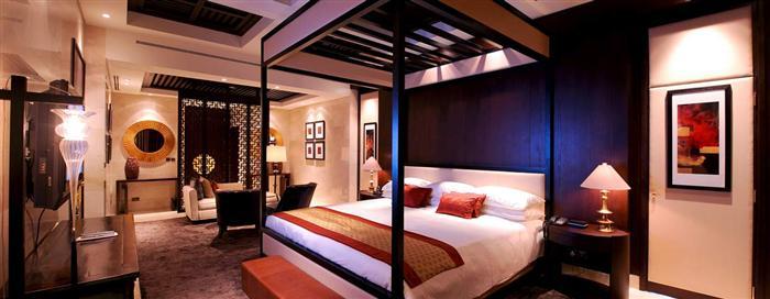 Спальня «Asian» королевского номера люкс в отеле Raffles Dubai