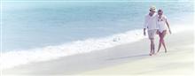 Promenade sur la plage au Raffles Seychelles