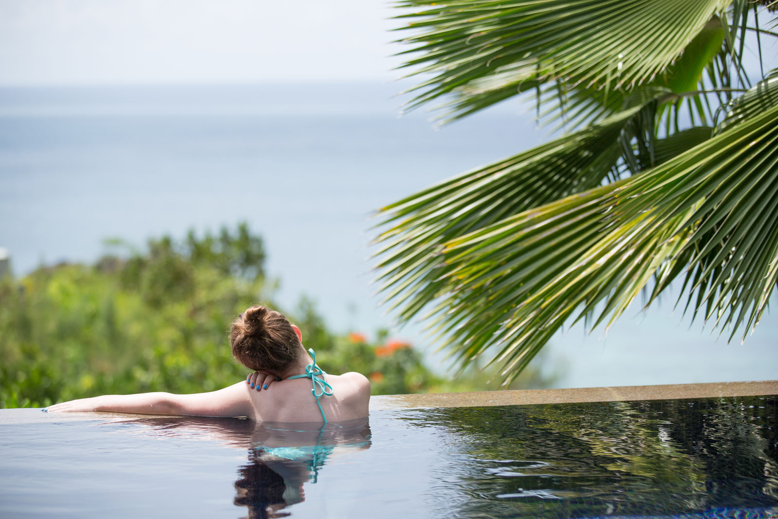 relaxing in the infinity pool of her private villa at Raffles Seychelles