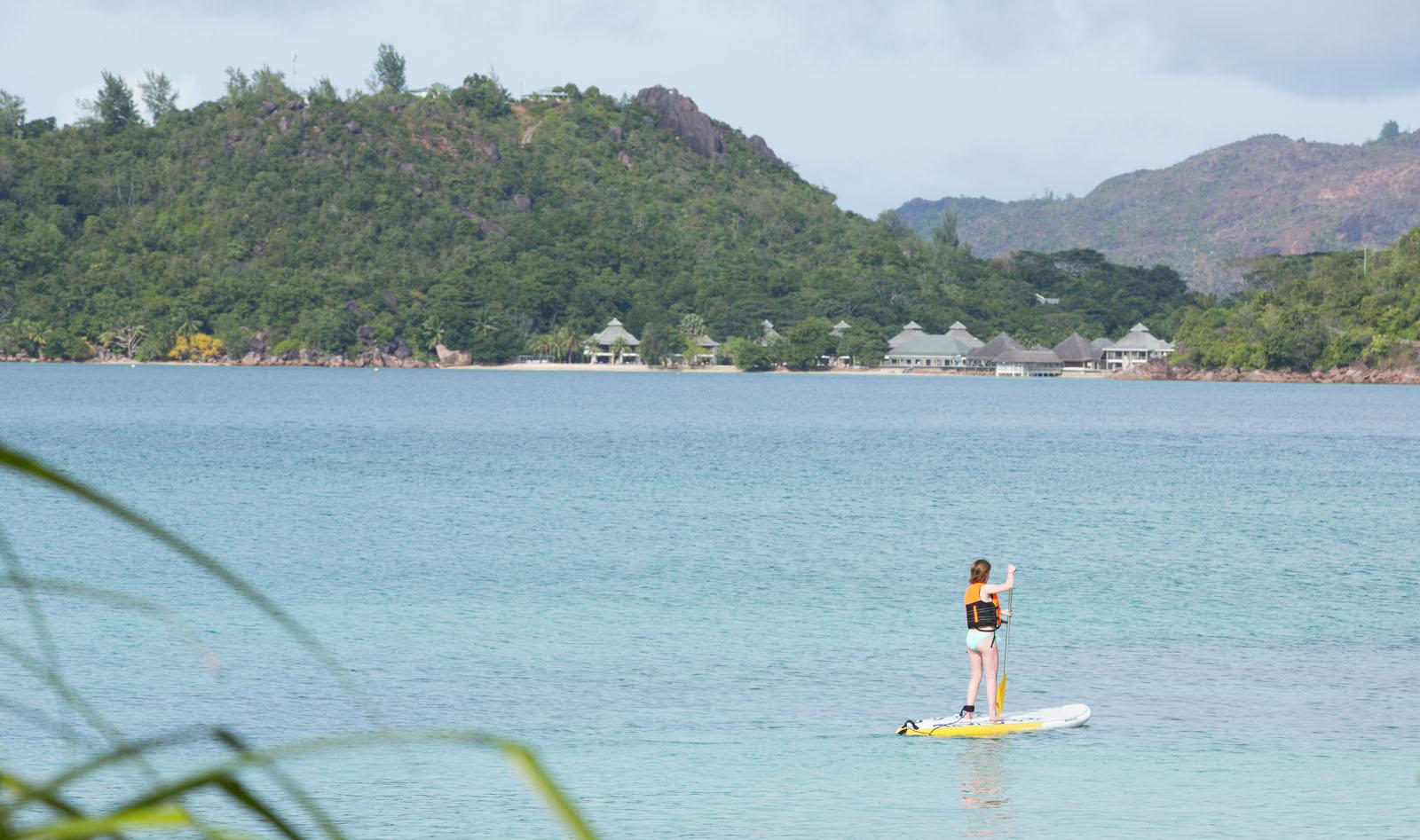 enjoying a paddle-boarding lesson