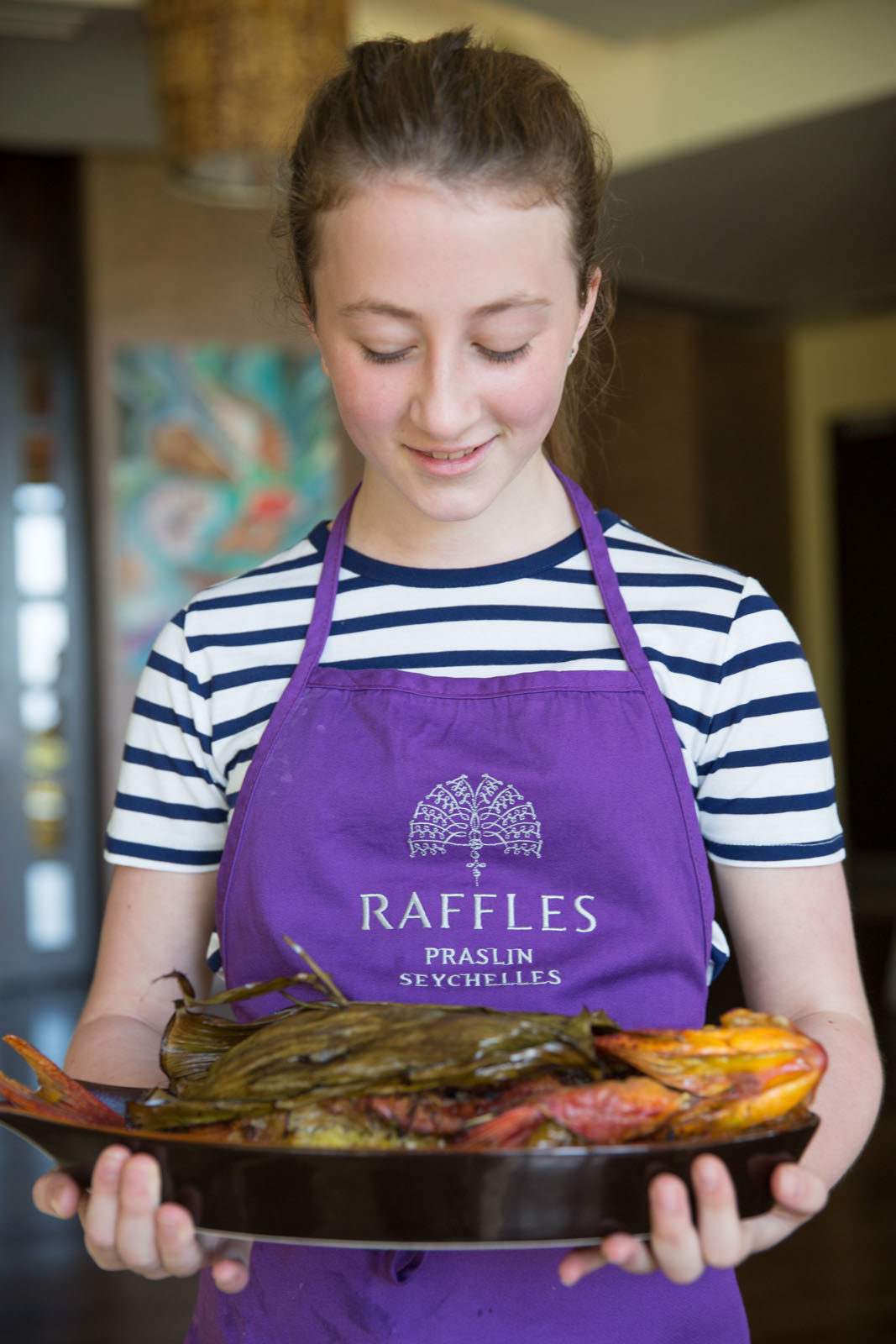 Eloise prepares a roast grouper cooked in a banana leaf