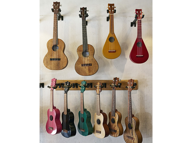 ukelele's hanging on a wall inside The Four Strings