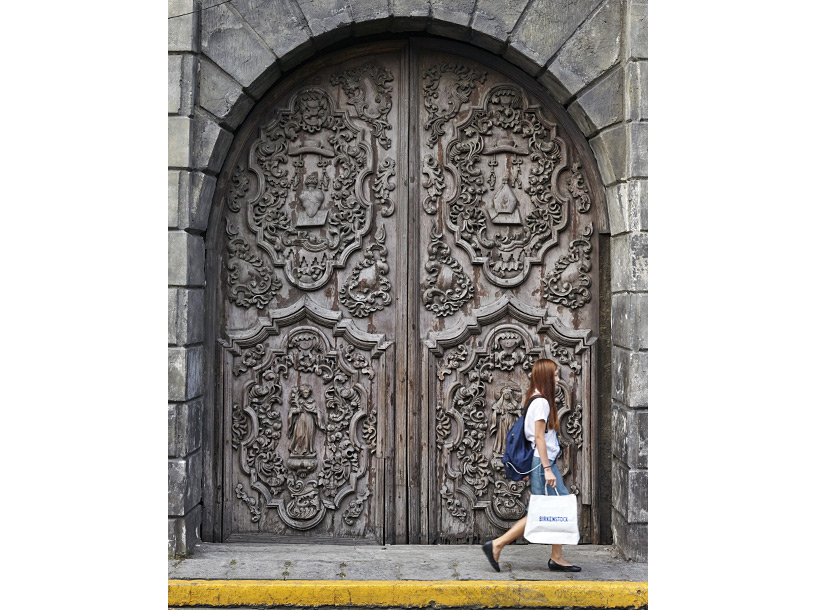 Large carved wooden door at St Augustine's Church
