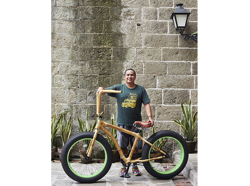 man standing beside a large Bambike