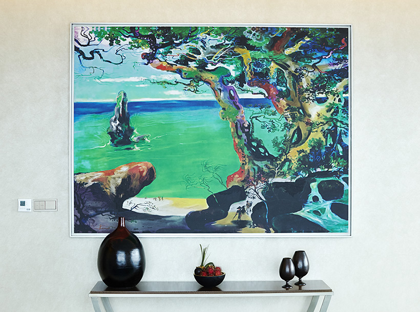Gunawan artwork featuring a multi coloured tree and blue water
