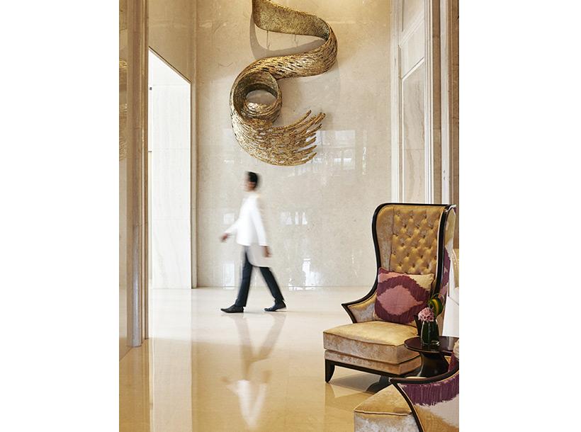Man walks through hotel lobby