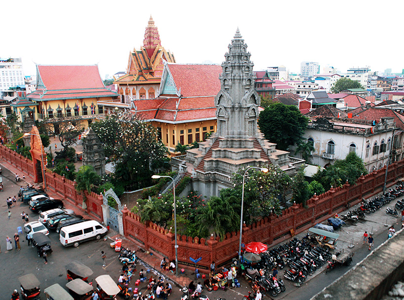 A temple surrounded by modern buildings