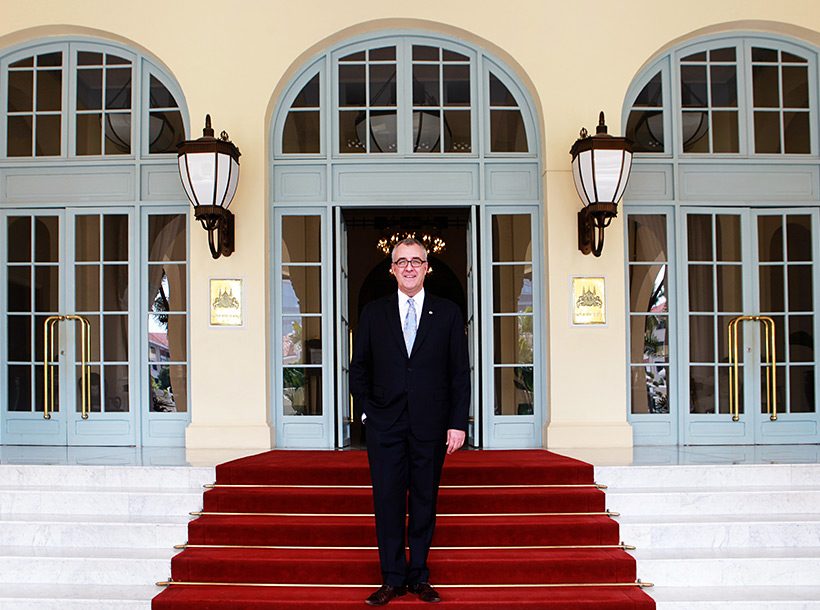 Director of sales and marketing standing infront of Raffles Hotel Le Royal