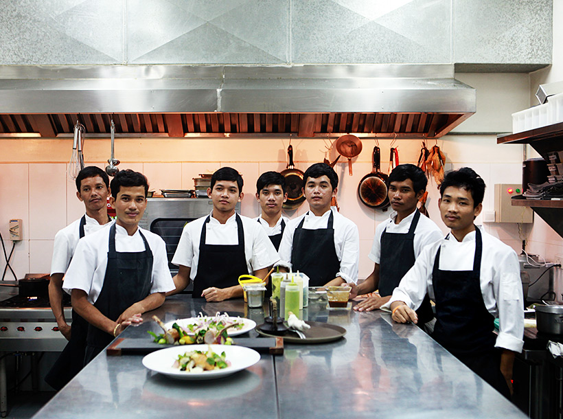 Chefs pose in the kitchen of The Common Tiger