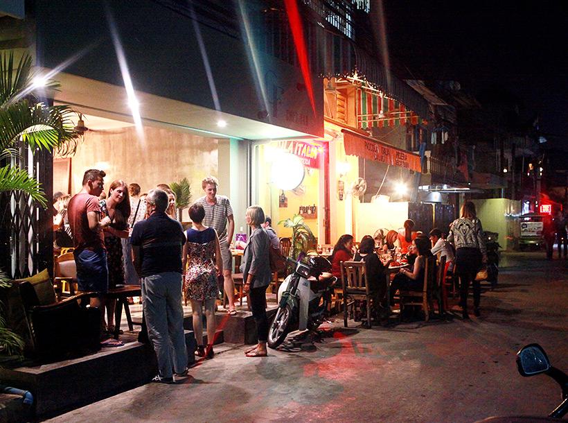 People socialising as a bar in Bassac Lane