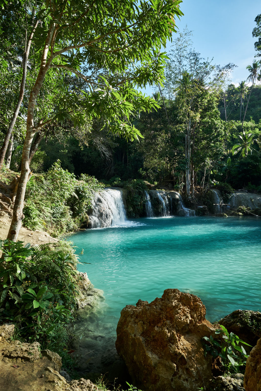 the three-tiered Cambugahay Falls in the interior of Siquijor Island