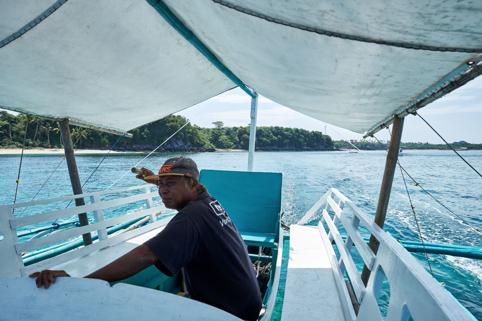 the captain of a tourist boat keeps a watchful eye