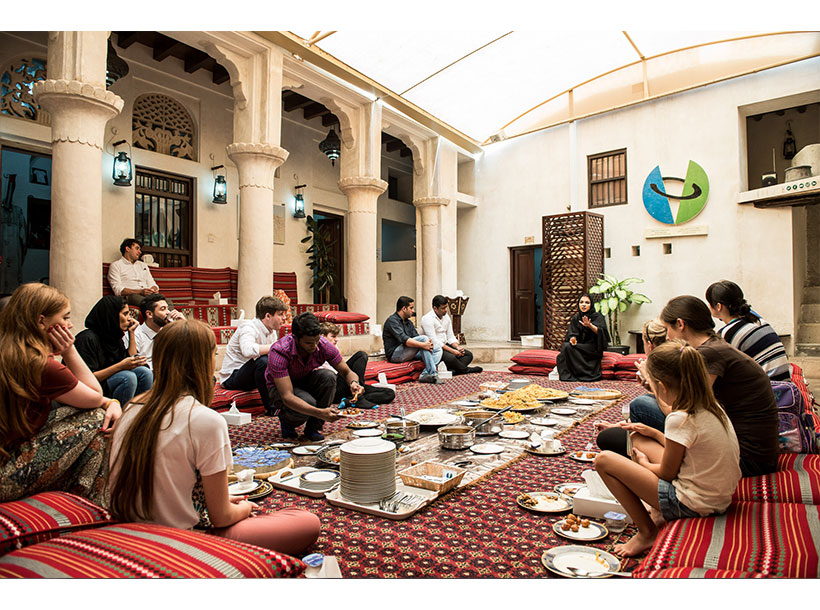 Visitors enjoy a meal at the Sheikh Mohammed Centre for Cultural Understanding